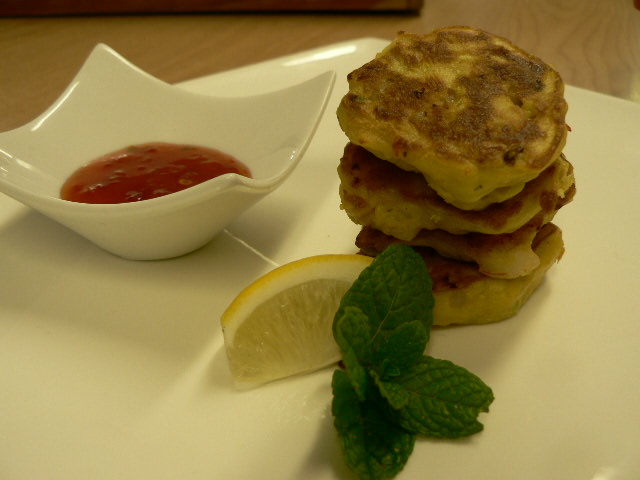 Corn and Kumara Brunch Fritters served with grilled bacon and tomatoes